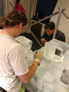 Matthew Griffith (left) and David LaNeve (right) sculpt ice blocks so that they will fit together more easily.