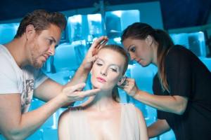 Makeup Artist Kevianno Guerrero and Hairstylist Alicia Zavarella touch up the model, Nicole Kristin